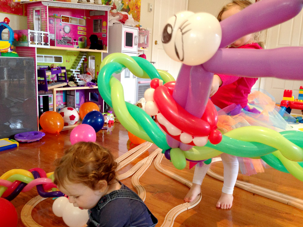 Balloons and toy trains track kids fun
